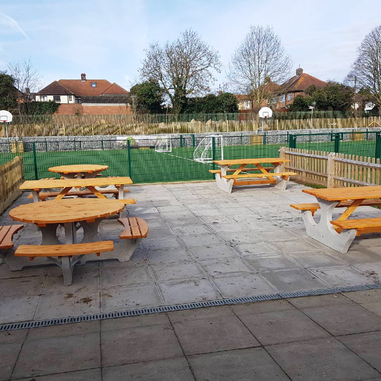 3 big benches and 2 round picnic tables